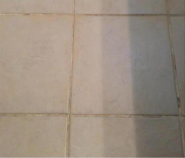 White tile that is very dirty